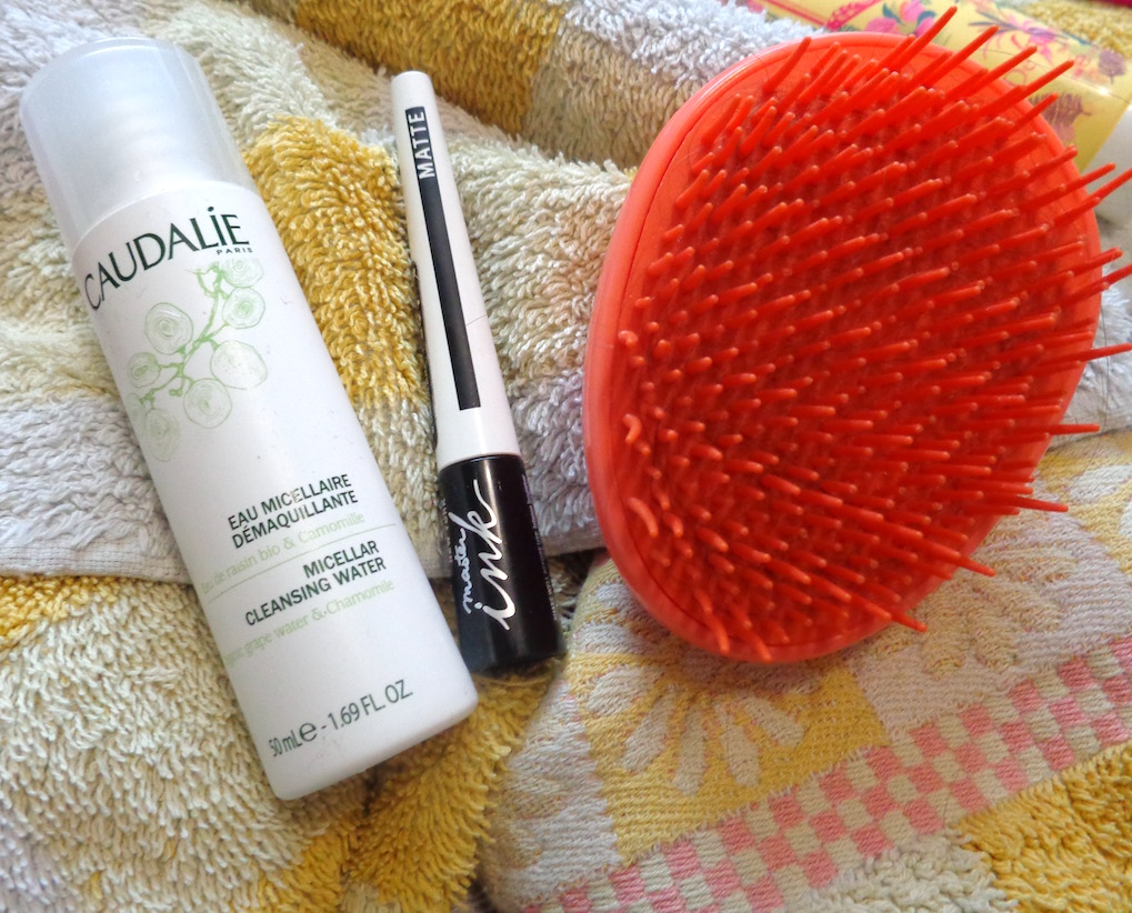image showing tangle teaser brush, caudalie cleanser and maybelline eyeliner
